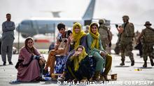 In this image courtesy of the US Marine Corps, evacuee children wait for the next flight after being manifested at Hamid Karzai International Airport, Kabul, Afghanistan, August 19, 2021. (Photo by Mark ANDRIES / US MARINE CORPS / AFP) / RESTRICTED TO EDITORIAL USE - MANDATORY CREDIT AFP PHOTO / Mark Andries / US MARINE CORPS - NO MARKETING - NO ADVERTISING CAMPAIGNS - DISTRIBUTED AS A SERVICE TO CLIENTS