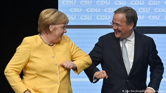 Armin Laschet, the conservative candidate for chancellor, with incumbent Angela Merkel