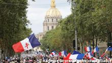 Demonstrators march during a far-right rally against the health pass, Saturday, Aug. 21, 2021 in Paris. People denounce a COVID-19 health pass needed to access restaurant, long-distance trains and other venues. (AP Photo/Adrienne Surprenant)