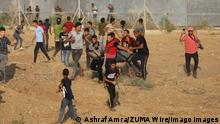 21.08.2021 August 21, 2021, Gaza city, Gaza Strip, Palestinian Territory: Palestinians clash with Israeli security forces following a demonstration along the Israel-Gaza border, east of Gaza city on the 52nd anniversary of the burning of the blessed Al-Aqsa Mosque, on August 21, 2021. Today, Saturday marks the 52nd anniversary of the evil attempt to burn the blessed Al Aqsa Mosque at a time when new and dangerous Israeli violations threaten the buildings and sanctities through excavations carried out by the Israeli occupation authorities underneath the mosques walls Gaza city Palestinian Territory - ZUMAap3_ 20210821_zaf_ap3_300 Copyright: xAshrafxAmrax