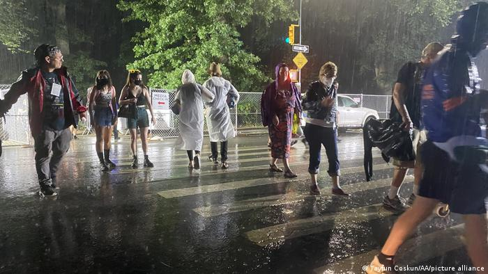 Central Park concertgoers drenched in rain