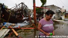 Martha Sanchez reacts while walking in front of her souvenir store that was destroyed when Hurricane Grace slammed into the coast with torrential rains, in Costa Esmeralda, near Tecolutla, Mexico August 21, 2021. REUTERS/Oscar Martinez