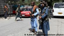 Taliban fighters stand guard at a checkpoint in the Wazir Akbar Khan neighborhood in the city of Kabul, Afghanistan, Wednesday, Aug. 18, 2021. The Taliban declared an amnesty across Afghanistan and urged women to join their government Tuesday, seeking to convince a wary population that they have changed a day after deadly chaos gripped the main airport as desperate crowds tried to flee the country. (AP Photo/Rahmat Gul)