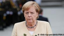 German Chancellor Angela Merkel takes part in a wreath-laying ceremony at the Tomb of the Unknown Soldier in Kyiv, Ukraine August 22, 2021. REUTERS/Gleb Garanich