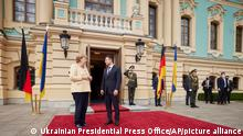 Ukrainian President Volodymyr Zelenskyy, right, greets German Chancellor Angela Merkel during their meeting in Kyiv, Ukraine, Sunday, Aug. 22, 2021. (Ukrainian Presidential Press Office via AP)