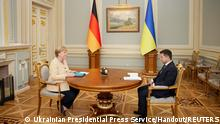 Ukrainian President Volodymyr Zelenskiy attends a meeting with German Chancellor Angela Merkel in Kyiv, Ukraine August 22, 2021. Ukrainian Presidential Press Service/Handout via REUTERS ATTENTION EDITORS - THIS IMAGE WAS PROVIDED BY A THIRD PARTY.