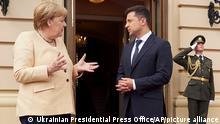 Ukrainian President Volodymyr Zelenskyy, right, and German Chancellor Angela Merkel talk during their meeting in Kyiv, Ukraine, Sunday, Aug. 22, 2021. (Ukrainian Presidential Press Office via AP)