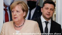 Ukrainian President Volodymyr Zelenskyy, right, and German Chancellor Angela Merkel enter a hall for a joint news conference following their talks at the Mariinsky palace in Kyiv, Ukraine, Sunday, Aug. 22, 2021. German Chancellor Angela Merkel arrived to Kyiv for a working visit to meet with top Ukrainian officials. (Sergey Dolzhenko/Pool Photo via AP)