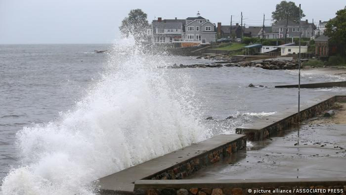 Waves hit a sea wall in Connecticut in advance of Henri