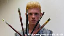 dpa-Exclusive _ Artist Leon Loewentraut poses with paintbrushes during a photo shoot in his small studio in Duesseldorf, Germany, 20 August 2015. The 17-year-old schoolboy from Kaarst, near Duesseldorf, is the new star of the arts scene. Photo: Horst Ossinger/dpa