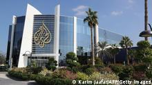 A picture taken on December 5, 2019, shows a general view of the headquarters of al-Jazeera Media Network, in the Qatari capital Doha. - Qatar-based broadcaster Al-Jazeera has travelled a long and bumpy road from the early 2000s when it was best known for airing tapes of former Al-Qaeda leader Osama bin Laden. It now cultivates a loyal youth audience on social media alongside the satellite channels which have won it both acclaim and scorn. (Photo by KARIM JAAFAR / AFP) (Photo by KARIM JAAFAR/AFP via Getty Images)
