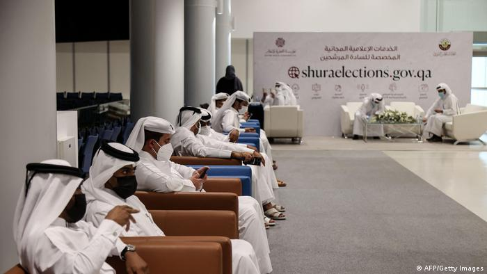 Qatari candidates wait to register to run in the country's upcoming election for members of its top advisory panel