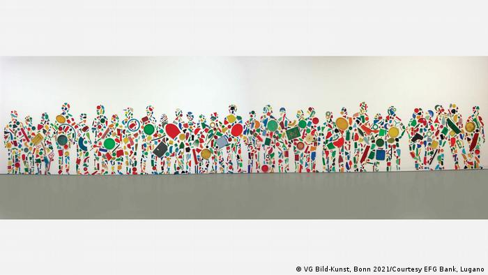 British artist Tony Cragg created this collection of people from plastic objects such as plates.