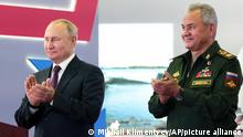 Russian President Vladimir Putin, left, and Russian Defense Minister Sergei Shoigu applaud during launching the construction of new nuclear submarines and other warships via video conference on the side of the International Military Technical Forum Army-2021 in Alabino, outside Moscow, Russia, Monday, Aug. 23, 2021. Putin has launched the construction of new nuclear submarines and other warships, part of a sweeping military modernization effort amid tensions with the West. He gave orders for two nuclear submarines armed with intercontinental ballistic missiles along with two diesel-powered submarines and two corvettes at shipyards in Severodvinsk, St. Petersburg and Komsomolsk-on-Amur. (Mikhail Klimentyev, Sputnik, Kremlin Pool Photo via AP)