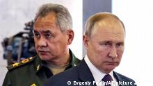 Russian President Vladimir Putin, right, and Russian Defense Minister Sergei Shoigu attend the launch of the construction of new nuclear submarines and other warships via video conference on the side of the International Military Technical Forum Army-2021 in Alabino, outside Moscow, Russia, Monday, Aug. 23, 2021. Putin has launched the construction of new nuclear submarines and other warships, part of a sweeping military modernization effort amid tensions with the West. He gave orders for two nuclear submarines armed with intercontinental ballistic missiles along with two diesel-powered submarines and two corvettes at shipyards in Severodvinsk, St. Petersburg and Komsomolsk-on-Amur. (Evgeniy Paulin, Sputnik, Kremlin Pool Photo via AP)