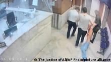 In this undated frame grab taken from video shared with The Associated Press by a self-identified hacker group called The Justice of Ali, guards drag an emaciated prisoner, at Evin prison in Tehran, Iran. The alleged hackers said the release of the footage was an effort to show the grim conditions at the prison, known for holding political prisoners and those with ties abroad who are often used as bargaining chips in negotiations with the West. (The Justice of Ali via AP)