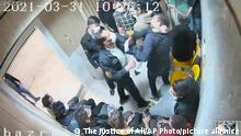 In this undated frame grab taken from video shared with The Associated Press by a self-identified hacker group called The Justice of Ali, a guard beats a prisoner, at Evin prison in Tehran, Iran. The alleged hackers said the release of the footage was an effort to show the grim conditions at the prison, known for holding political prisoners and those with ties abroad who are often used as bargaining chips in negotiations with the West. (The Justice of Ali via AP)