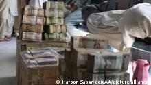 KABUL, AFGHANISTAN-JULY 16: A view of Afghan currency at exchange market as dealers have been hit hard following the fall in value of the Afghani currency, leading to a rise in food prices in Kabul, Afghanistan, on July 16, 2021. The departure of foreign troops and the advance of the Taliban is contributing to mounting political and economic insecurity in the country. Haroon Sabawoon / Anadolu Agency