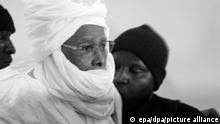 FILE - Former Chadian leader Hissene Habre (C) is escorted in to stand trial at the Palais de Justice in Dakar, Senegal, 20 July 2015. The former Chadian leader is accused of crimes against humanity, war crimes and torture allegedly perpetrated during his rule between 1982 to 1990. EPA/STR (zu dpa Urteil im Prozess gegen Tschads Ex-Diktator Habré erwartet vom 29.05.2016) +++ dpa-Bildfunk +++