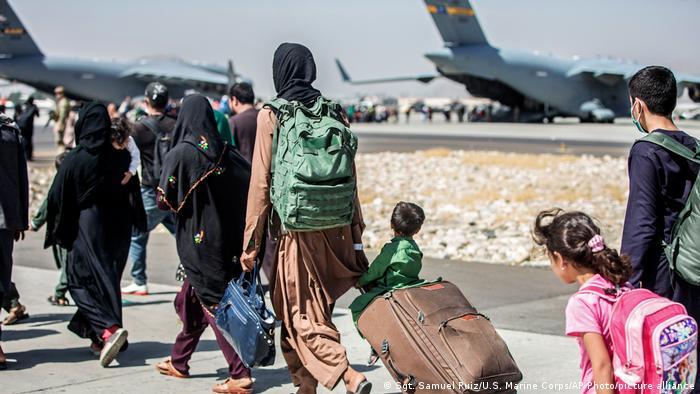 Afghans wait to board evacuation flights at Kabul airpot