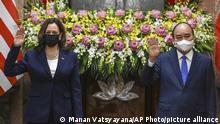 U.S. Vice President Kamala Harris, left, and Vietnam's President Nguyen Xuan Phuc pose for a photograph in the Presidential Palace in Hanoi, Vietnam, Wednesday, Aug. 25, 2021. (Manan Vatsyayana/Pool Photo via AP)