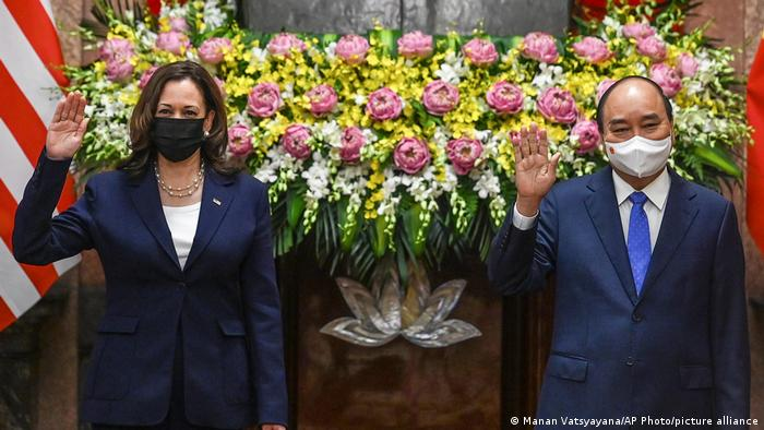 US Vice President Kamala Harris, left, and Vietnam's President Nguyen Xuan Phuc, pose for a photograph in the Presidential Palace in Hanoi, Vietnam, Wednesday, Aug. 25, 2021.