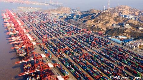 Aerial view of shipping containers sitting stacked at Yangshan Deepwater Port