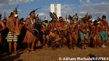 Indigenous Brazilians take part in a protest for land demarcation and against President Jair Bolsonaro's government, next to the National Congress in Brasilia, Brazil August 24, 2021. REUTERS/Adriano Machado