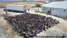 VAN, TURKEY - AUGUST 03: Irregular migrants are seen after they were caught in the trailer of a truck by gendarmerie in Caldiran district of Van, Turkey on August 03, 2021. Necmettin Karaca / Anadolu Agency