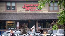 This Aug. 18, 2021 shows the Jackson Hole Resort Store downtown Jackson, Wyo. The outdoor clothing and gear company Patagonia has decided to quit supplying Jackson Hole Mountain Resort with its products, fallout from the resort owner Jay Kemmerer's support of the House Freedom Caucus. The resort, which is Patagonia's largest single customer in the Jackson Hole area, operates retail stores in Teton Village and the town of Jackson. The outdoor gear and clothing company Patagonia has stopped providing its merchandise for sale at a Wyoming ski resort to protest the owners' sponsorship of a Republican fundraiser featuring Marjorie Taylor Greene and other core supporters of former President Donald Trump. (Bradly J. Boner/Jackson Hole News