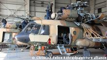 17 February 2018, Afghanistan, Kandahar: Technicians repair an old Russian MI-17 helicopter of the Afghan air force. The air force is tasked with putting pressure on the radical Taliban group in the country. Photo: Christine-Felice Röhrs/dpa