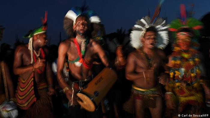 Members of different indigenous tribes protest outside the Supreme Court Building in Brasilia, on August 24, 2021.