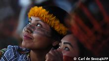 Women of the Huni Kuin tribe attend a ceremony at a protest camp in Brasilia, on August 22, 2021. - Over 1000 indigenous protestors have converged on Brasilia to take part in a week of protests organised by Brazilís Indigenous People Articulation (APIB). The main focus of the protests is a judgement at the Supreme Court (STF) taking place on August 25, which may define the future demarcation of indigenous lands. (Photo by CARL DE SOUZA / AFP)