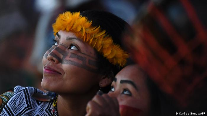 Women of the Huni Kuin tribe attend a ceremony at a protest camp in Brasilia, on August 22, 2021.