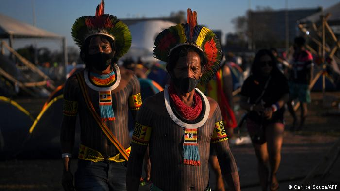 Members of the Kayapo tribe wear face masks at a protest camp in Brasilia, on August 22, 2021.