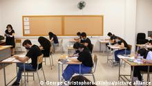 (210521) -- NICOSIA, May 21, 2021 (Xinhua) -- Students wearing face masks have an exam at a school in Nicosia, Cyprus, on May 21, 2021. Pancyprian examinations started on May 21 with all students obliged to present a negative coronavirus test. Special arrangements are also put in for COVID-19 patients, close contacts and those who did not present a negative coronavirus test. (Photo by George Christophorou/Xinhua)