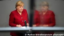 German Chancellor Angela Merkel delivers her speech during a special session of the German parliament Bundestag on Afghanistan in Berlin, Germany, Wednesday, Aug. 25, 2021. (Photo/Markus Schreiber)