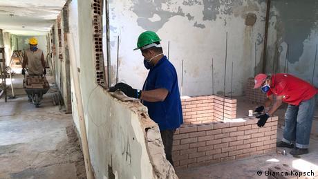 Man building a wall in Brazil