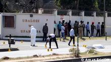 Police securing the scene where an attacker wielding an assault rifle was shot dead after killing three police officers and an employee of a private security company near the French embassy in Dar es Salaam.