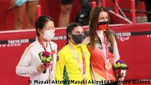 (L to R) China's WANG Xiaomei, silver, Australia's GRECO Paige, gold, and Germany's SCHINDLER Denise, bronze, attend a victory ceremony of Women's C1-3 3000m Individual Pursuit during Summer Paralympic Games at Izu Velodome in Izu, Shizuoka Prefecture on Aug. 25, 2021. ( The Yomiuri Shimbun via AP Images )
