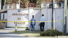 Tanzanian security forces guard an entrance to the French embassy after an attacker wielding an assault rifle was killed in the Salenda area of Dar es Salaam, Tanzania August 25, 2021. REUTERS/Emmanuel Herman NO RESALES. NO ARCHIVES