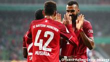 BREMEN, GERMANY - AUGUST 25: Jamal Musiala of FC Bayern Muenchen celebrates with teammate Eric Maxim Choupo-Moting after scoring their team's second goal during the DFB Cup first round match between Bremer SV and Bayern Munchen at Wohninvest Weserstadion on August 25, 2021 in Bremen, Germany. (Photo by Joern Pollex/Getty Images)