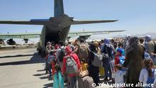 Operation to transport Afghan evacuees Some 380 Afghans who have worked for South Koreans in their war-ravaged nation and their family members board a South Korea military plane at an airport in Kabul on Aug. 25, 2021, to head for South Korea, in this photo provided by the Air Force. (PHOTO NOT FOR SALE) (Yonhap)/2021-08-26 11:38:58/