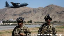 August 24, 2021 - Kabul, Afghanistan - Two Paratroopers assigned to the 1st Brigade Combat Team, 82nd Airborne Division conduct security while a C-130 Hercules takes off during a non-combatant evacuation operation in Kabul, Afghanistan, August 25. The Department of Defense is supporting the Department of State in evacuating U.S. civilian personnel, Special Immigrant Visa applicants, and other at-risk individuals from Afghanistan as quickly and safely as possible. Kabul Afghanistan - ZUMAz03_ 20210824_szp_z03_090 Copyright: xDoDx