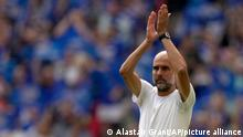 Manchester City's head coach Pep Guardiola applauds to fans before the English FA Community Shield soccer match between Leicester City and Manchester City at Wembley stadium, in London, Saturday, Aug. 7, 2021. (AP Photo/Alastair Grant)