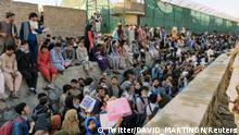 Crowds of people wait outside the airport in Kabul, Afghanistan August 25, 2021 in this picture obtained from social media. Twitter/DAVID_MARTINON via REUTERS THIS IMAGE HAS BEEN SUPPLIED BY A THIRD PARTY. MANDATORY CREDIT. NO RESALES. NO ARCHIVES