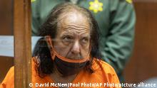 FILE - Adult film star Ron Jeremy appears for his arraignment on rape and sexual assault charges on June 26, 2020, at Clara Shortridge Foltz Criminal Justice Center, in Los Angeles. Authorities say Jeremy has been indicted on more than 30 counts of sexual assault involving 21 women and girls dating back more than two decades. The 68-year-old prolific porn performer whose legal name is Ronald Hyatt, pleaded not guilty in Los Angeles Superior Court on Wednesday, Aug. 25, 2021, to all of the allegations, including 12 counts of rape. (David McNew/Pool Photo via AP, File)