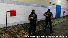 In this photo released by the Montenegro Police, said to show over 1 ton (2,000 pounds) of cocaine hidden in a shipment of bananas. Police on Thursday evening discovered 1,250 packages of cocaine in the village of Mojanovici, near the capital Podgorica.(Montenegro Police via AP)