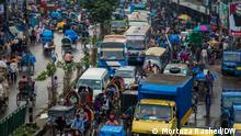 The strict Corona lockdown is over after almost four months. From public transport to offices and markets are also back to its normalcy. The pictures show how traffic jam on streets, crowd on different places have changed the way of life quickly. Place: Dhaka, Bangladesh Copyright: Photographer- Mortuza Rashed. DW