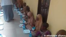 Some freed students of Salihu Tanko Islamic School, have their breakfast at Bosso Low- cost primary health care centre in Bosso, Nigeria, Friday, Aug 27, 2021. A school official in northern Nigeria says gunmen have released some of the more than 100 children who had been abducted back in May. The kidnapping victims from the Salihu Tanko Islamic School in Niger state had included children as young as 5 years old. (AP Photo)